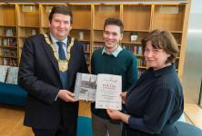 dlr Cathaoirleach Barry Saul, with prizewinner Fionn O'Sullivan and dlr Writer in Residence, Selina Guinness in dle LexIcon